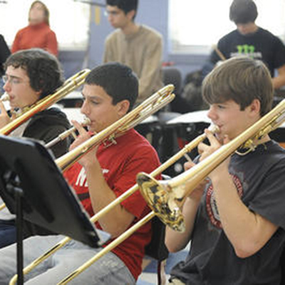 Trombone students playing in school band