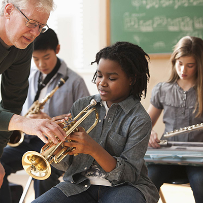 Music teacher working with students